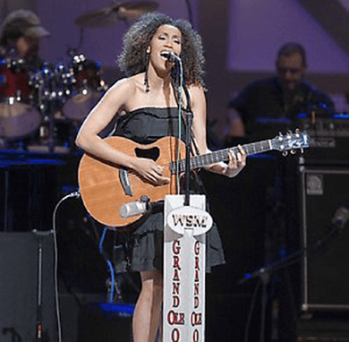 indie bible music promotion: image of a singer performing live on stage at the grand ol opry