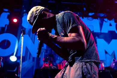 indie bible music promotion: image of a hop hop artist performing live on stage