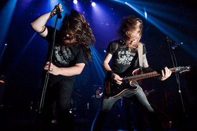 indie bible music promotion: image of a metal band performing live on stage