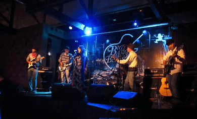 indie bible music promotion: image of a blues band performing live on stage