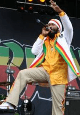 indie bible music promotion: image of a reggae artist performing live on stage